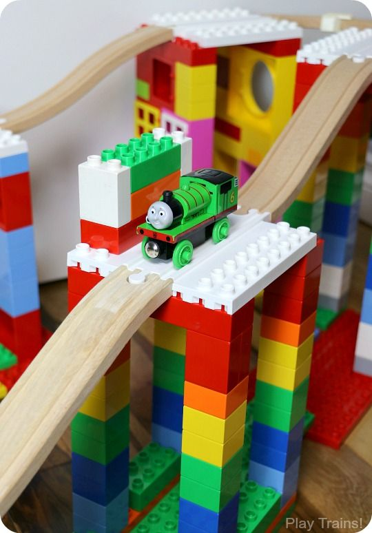 http://play-trains.com/creative-building-play-duplo-and-wooden-train-tracks/